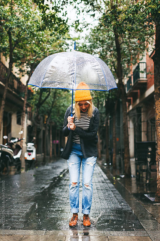 Woman enjoying in a rainy day. by BONNINSTUDIO for Stocksy United