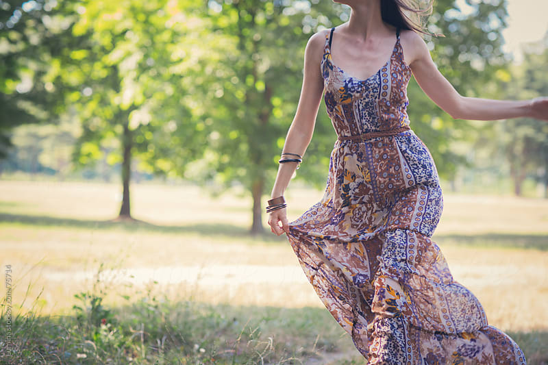 Woman in a Dress Outdoors by Lumina for Stocksy United