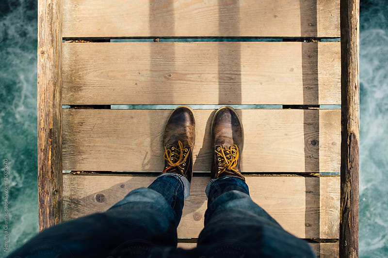 Male Hiker Legs on a Wooden Bridge Over  by Nemanja Glumac for Stocksy United