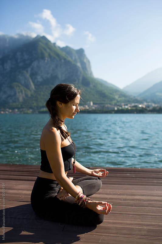Woman doing yoga pose: Padmasana by michela ravasio for Stocksy United