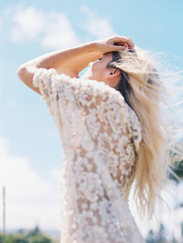 Blonde girl in lace against blue sky by wendy laurel for Stocksy United