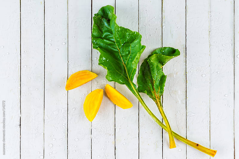 Organic Sliced Golden Beets and Greens by suzanne clements for Stocksy United