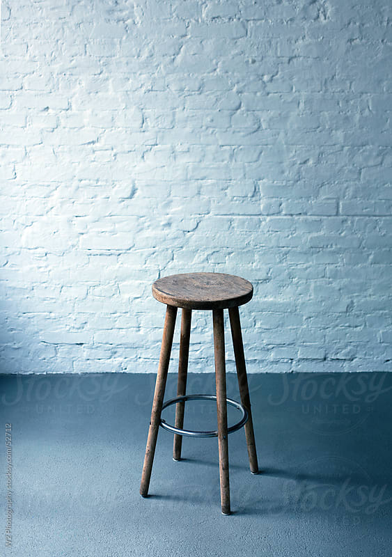 Empty stool in a studio space. by W2 Photography for Stocksy United