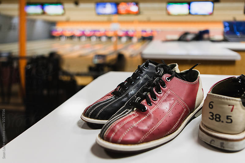 Bowling: Rental Bowling Shoes Sitting On Counter by Sean Locke for Stocksy United