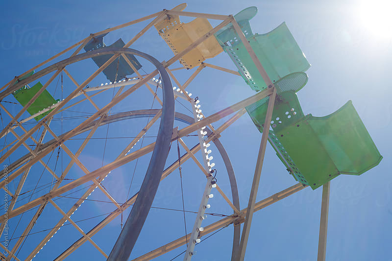 Ferris Wheel against a blue sky by Carolyn Lagattuta for Stocksy United