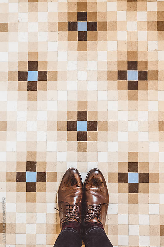 Vintage tiles and oxford shoes by Vera Lair for Stocksy United