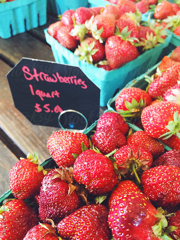 Strawberries at a farmers market by Chelsea Victoria for Stocksy United