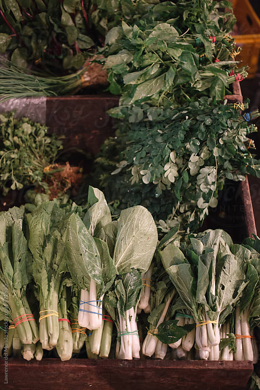 Fresh organically grown vegetables at the public market by Lawrence del Mundo for Stocksy United