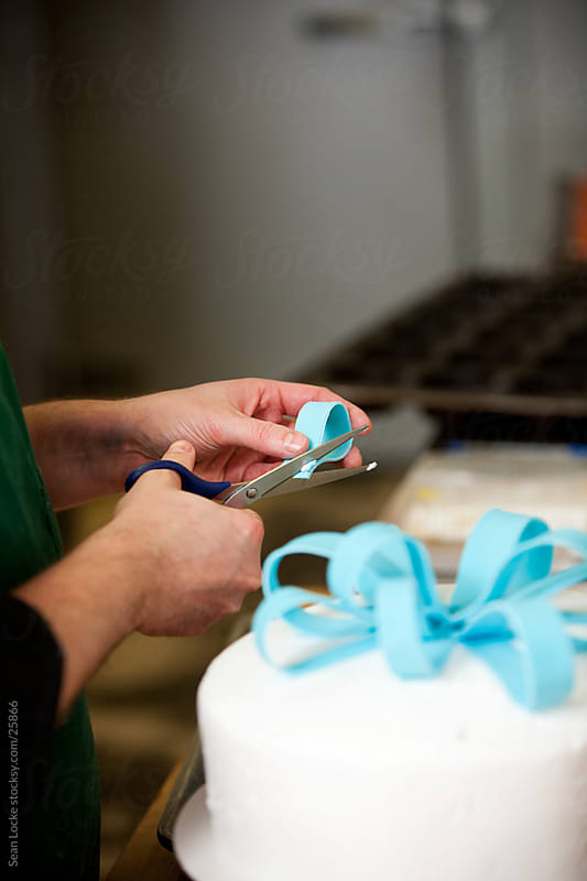 Bakery: Baker Working on Fancy Decorated Cake by Sean Locke for Stocksy United