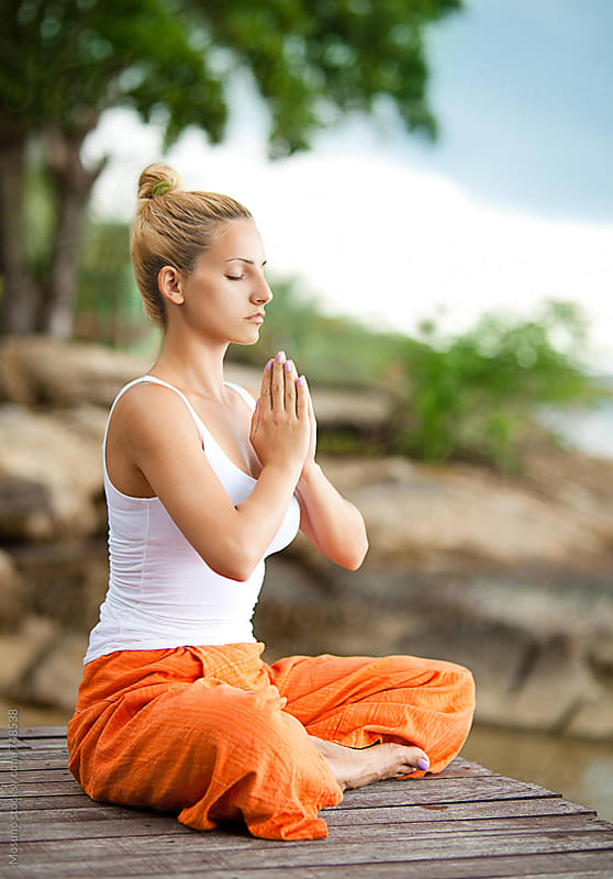 Woman Meditating in Nature by Mosuno for Stocksy United