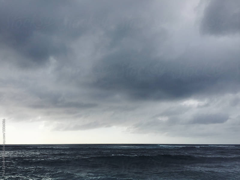 Dark storm clouds over Pacific Ocean, North Shore, Oahu, Hawaii by Paul Edmondson for Stocksy United