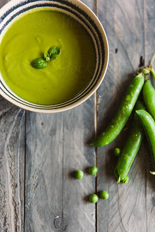 Pea, mint and basil soup. by Helen Rushbrook for Stocksy United