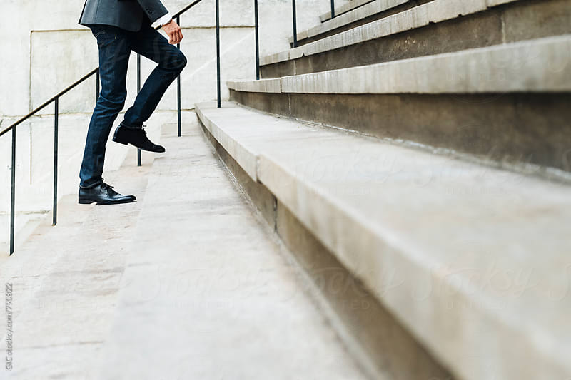 Businessman walking on the stairs by GIC for Stocksy United