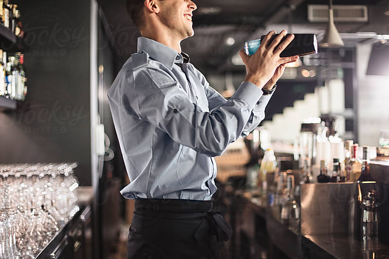 Bartender Making a Cocktail by Lumina for Stocksy United