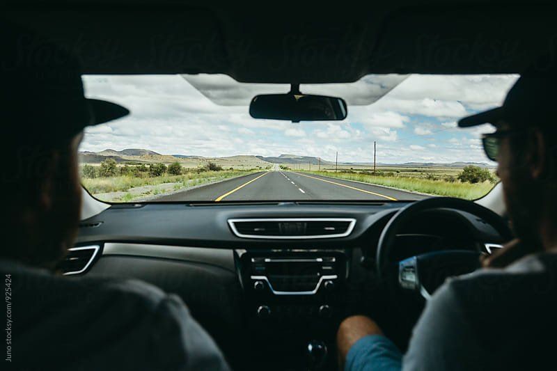 view through a car window on the open road by Micky Wiswedel for Stocksy United