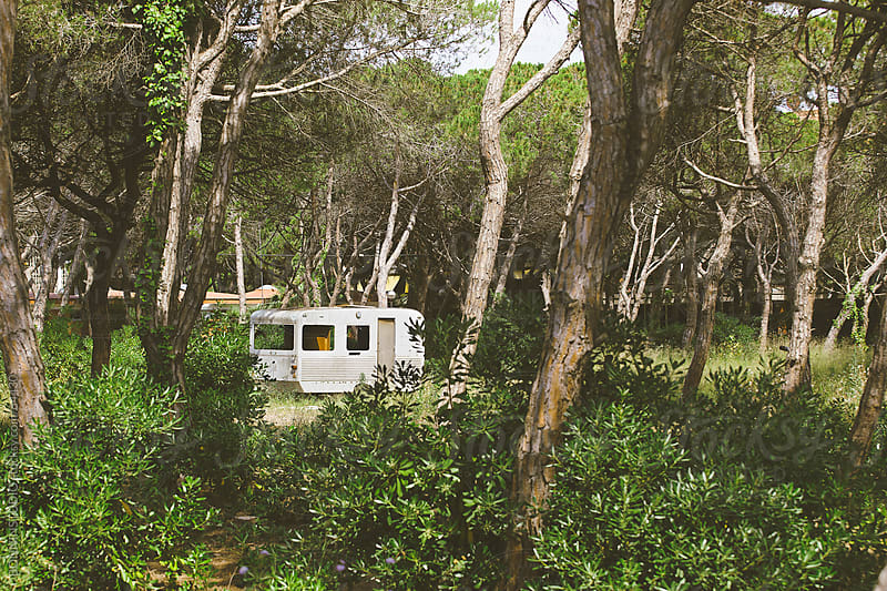 Old and abandoned caravan on forest. by BONNINSTUDIO for Stocksy United