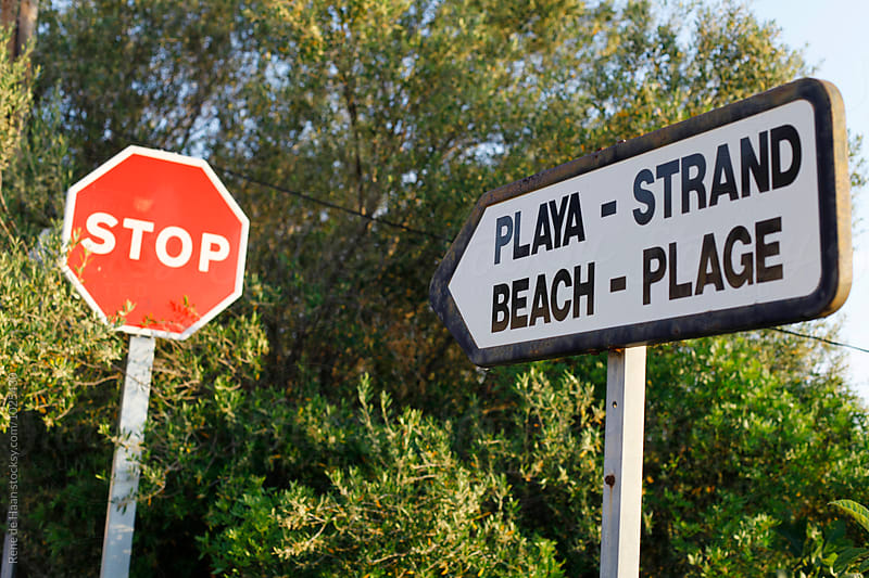 beach + stop sign  by Rene de Haan for Stocksy United