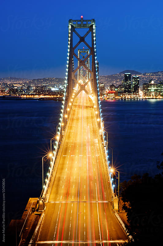 Traffic on the Bay Bridge at night by Anna-Marie Panlilio for Stocksy United