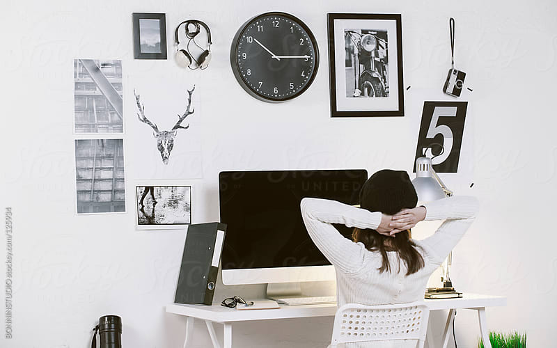 Modern workspace with a creative woman worker. Woman relaxing at office. by BONNINSTUDIO for Stocksy United