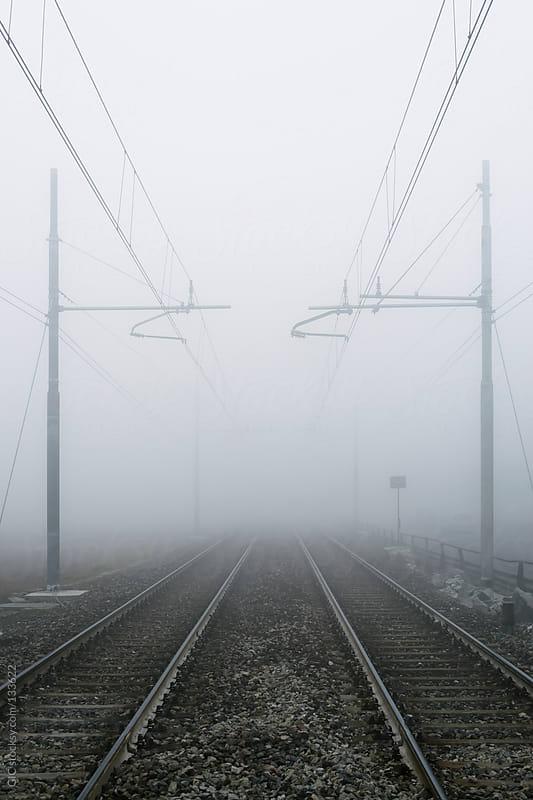 Railroad tracks in the fog by GIC for Stocksy United