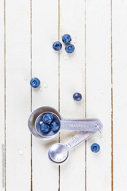 Fresh Organic Blueberries and Measuring Spoon by suzanne clements for Stocksy United