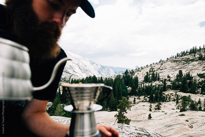 Mountain man making coffee by Isaiah & Taylor Photography for Stocksy United