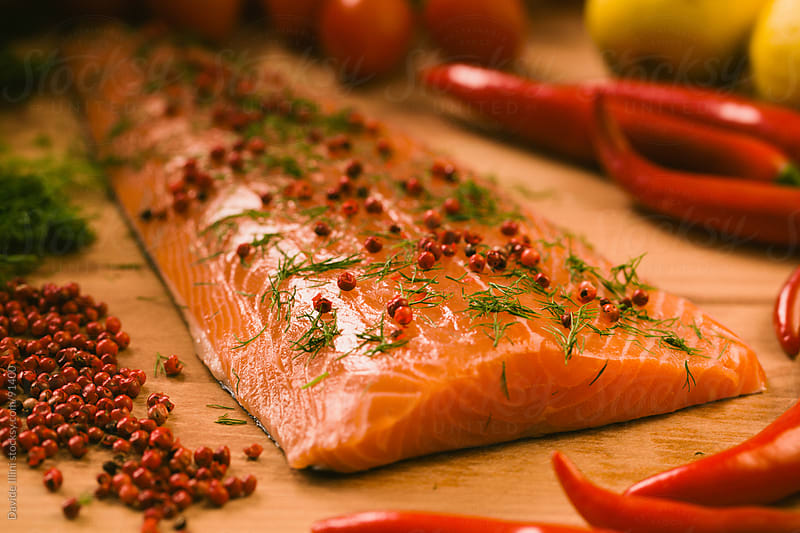 Raw salmon fillet by Davide Illini for Stocksy United
