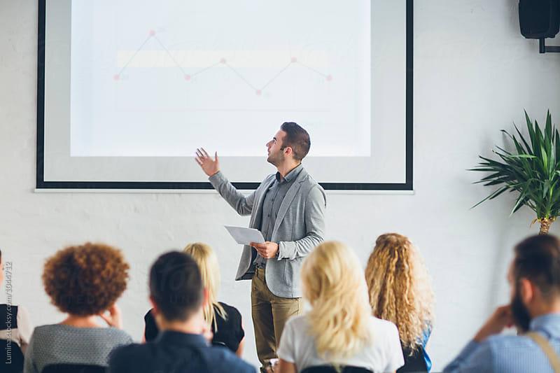 Businessman Making a Presentation  by Lumina for Stocksy United