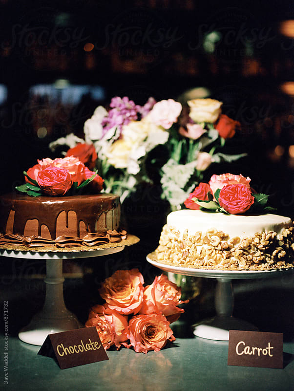 Colorful cakes and flowers by Dave Waddell for Stocksy United