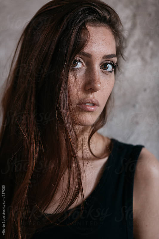 Portrait of young brunette looking at camera by Alberto Bogo for Stocksy United