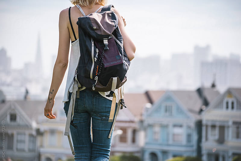 Woman with backpack traveling in San Francisco by Simone Becchetti for Stocksy United