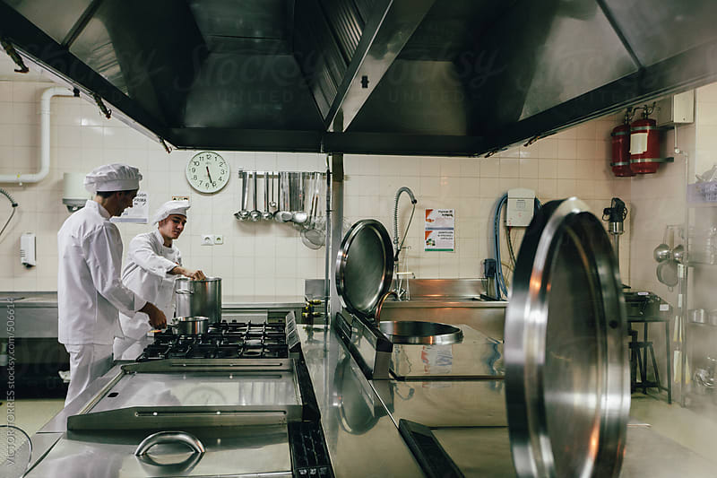 Chef Preparing Food in a Professional Kitchen by VICTOR TORRES for Stocksy United