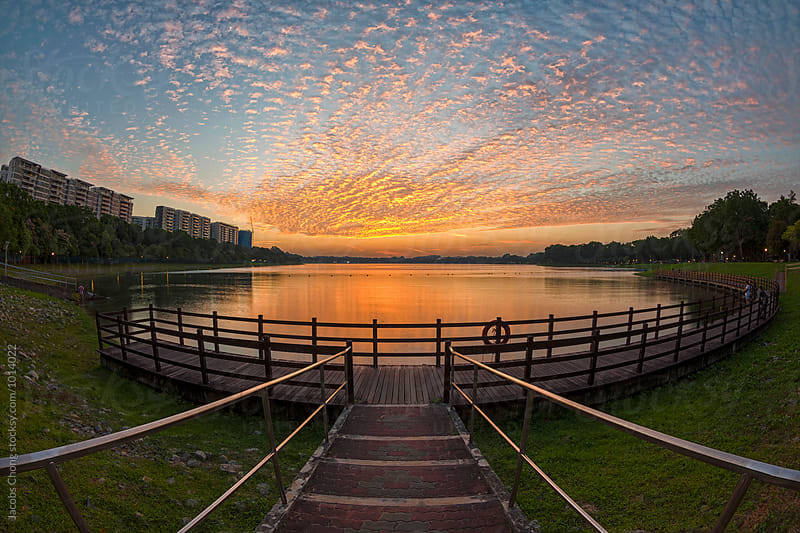 Fiery Sunset at Bedok Reservoir by Jacobs Chong for Stocksy United