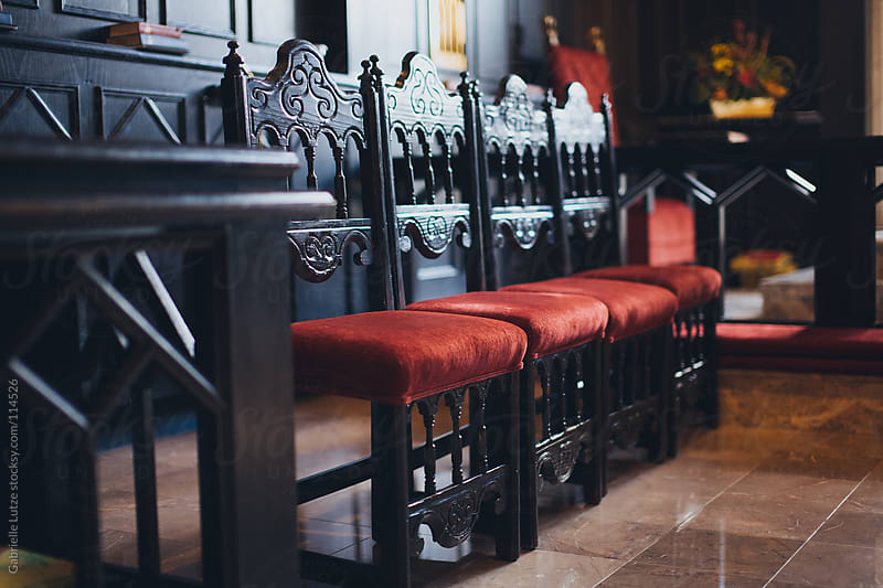 Antique Chairs in a church by Gabrielle Lutze for Stocksy United