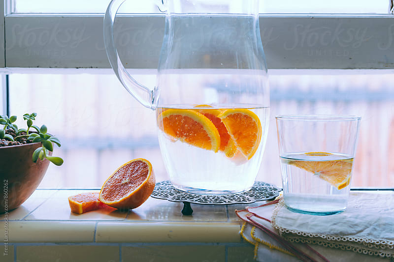 Fresh homemade citrus water in jar by Trent Lanz for Stocksy United