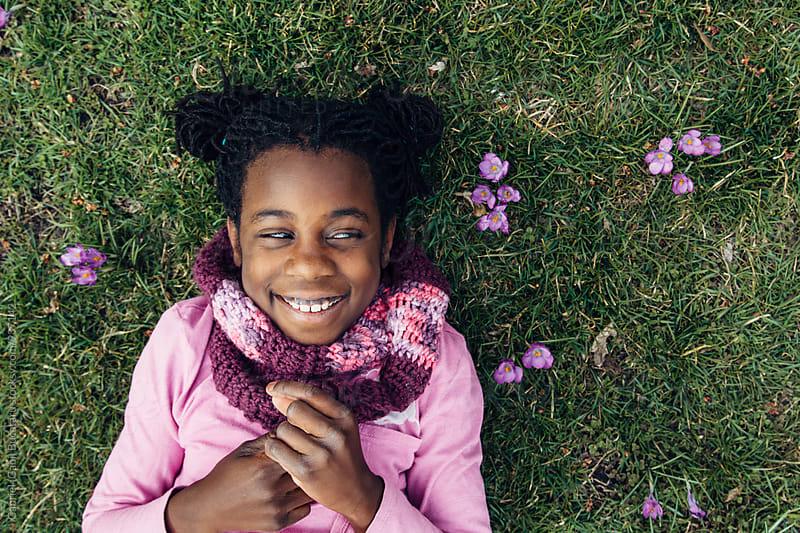 Happy African American girl on the grass by Gabriel (Gabi) Bucataru for Stocksy United