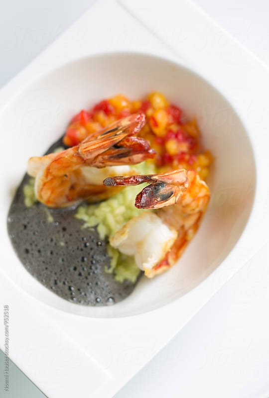 Fried prawn on avocado risotto by Noemi Hauser for Stocksy United