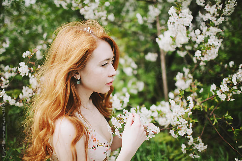 Portrait of a young girl in the spring garden by Sergey Filimonov for Stocksy United