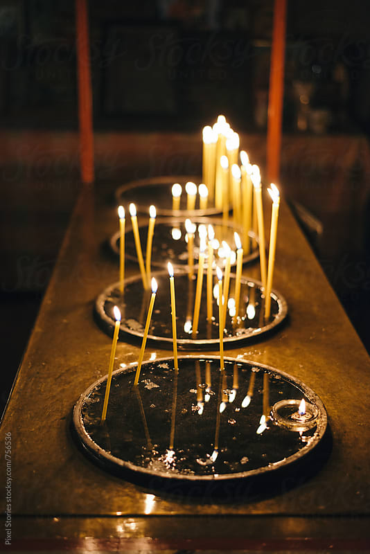 Candles inside a church by Pixel Stories for Stocksy United