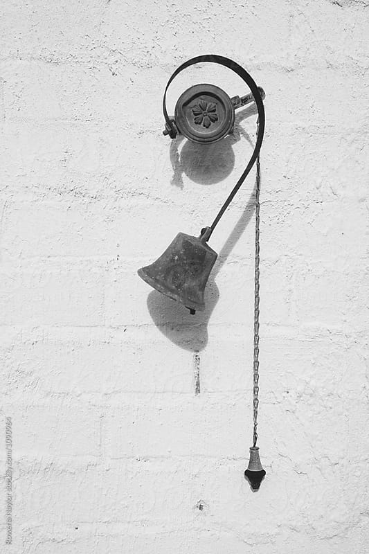 Antique house bell on white wall by Rowena Naylor for Stocksy United