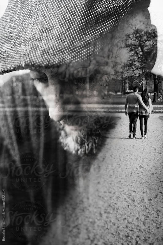 Double exposure of a very sad man who recalls his younger age by Beatrix Boros for Stocksy United