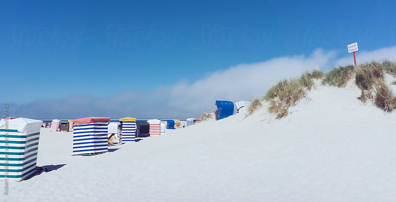 Beach huts along the North Sea by Robert Kohlhuber for Stocksy United