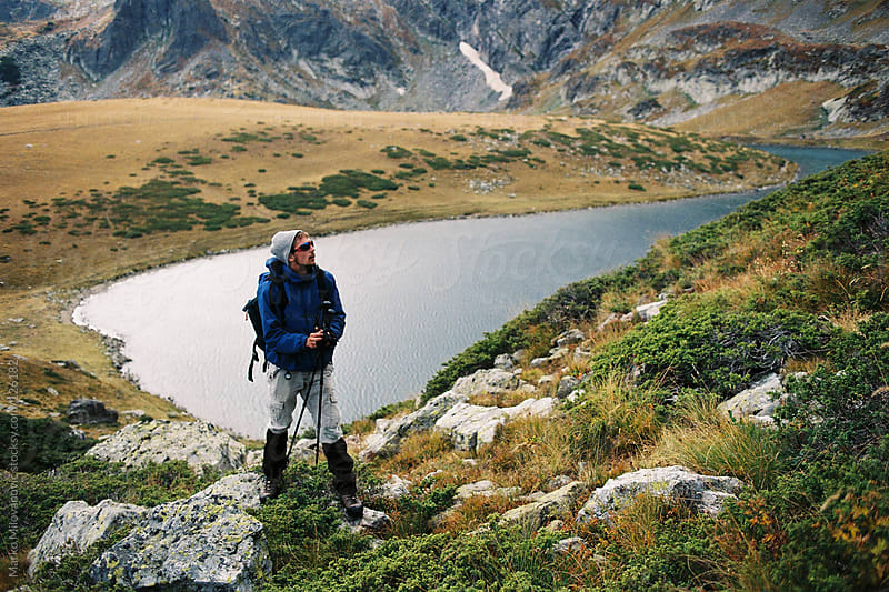 Young hiker, lake in background by Marko Milovanović for Stocksy United