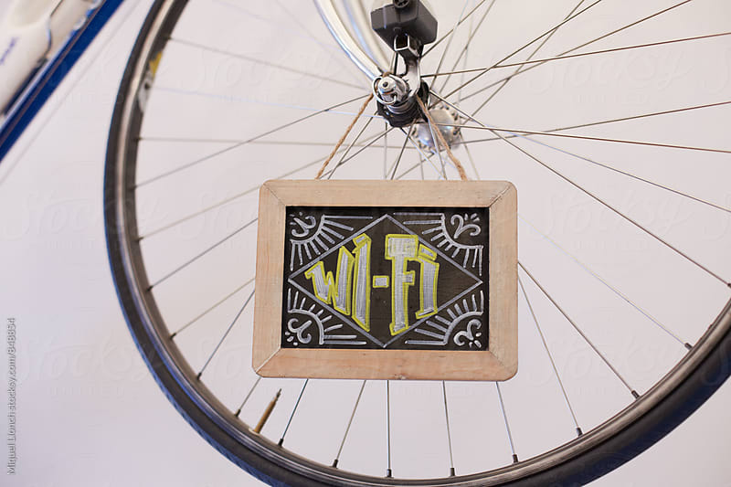 Wifi sign on a bicycle wheel by Miquel Llonch for Stocksy United