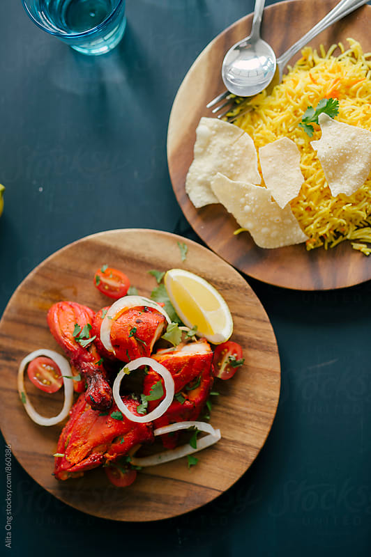 Tandoor chicken served with pilau rice by Alita Ong for Stocksy United