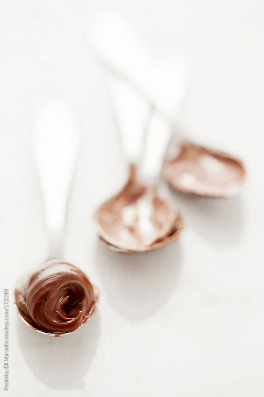 Hazelnut cream on a teaspoon by Federica Di Marcello for Stocksy United