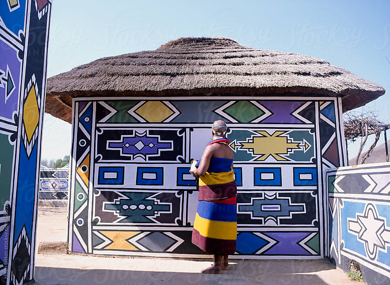 Ndebele woman painting her house. South Africa.  by Hugh Sitton for Stocksy United