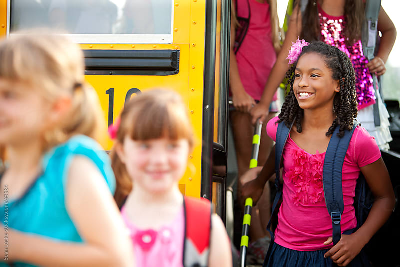 School Bus: African American Girl Gets Off of Bus by Sean Locke for Stocksy United