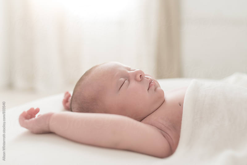 Close Up Of A Newborn's Profile by Alison Winterroth for Stocksy United