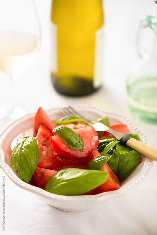 Tomato Salad with Basil in Bowl by Jeff Wasserman for Stocksy United